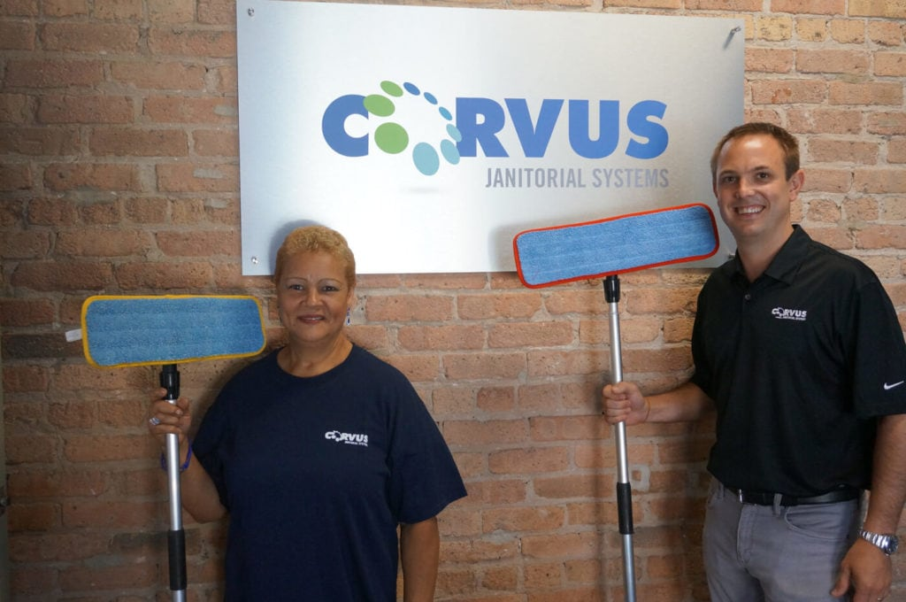 Two Corvus franchisee's posing with mops