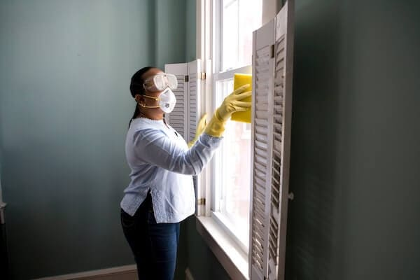 woman cleaning and disinfecting home