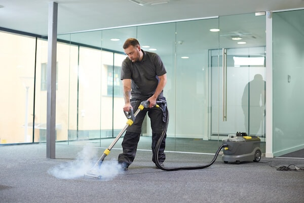 man performing carpet extraction for floor care