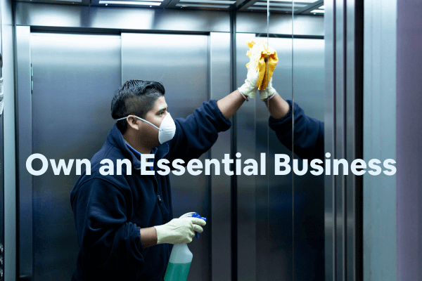 man who owns a cleaning business cleaning an elevator