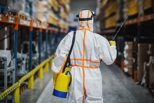 industrial cleaning - man spraying disinfectants