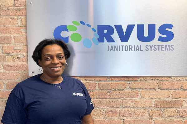 Corvus franchise owner Marcia Byrd in front of Corvus sign