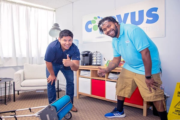 Two successful cleaning franchise owners smiling