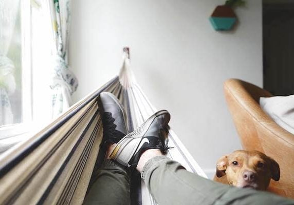 Manage stress at home: man in hammock